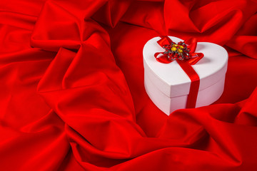 love card with heart on a red fabric