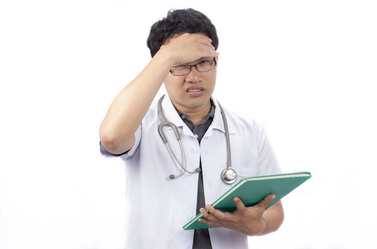 A doctor banging his head realizing a mistake