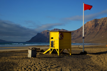 lifeguard chair red flag in spain   coastline and summer