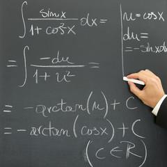 Businessman writing scientific formula