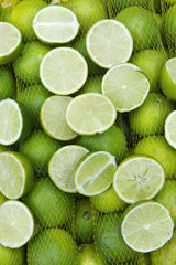 Fresh Limes Hanging in Sacks at Farmers Market Rio de Janeiro