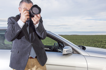 Man standing in front of the car and photographed