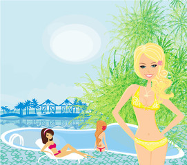 girls and tropical pool