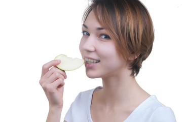 Pretty young girl with piece of green apple