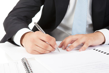 Businessman  hands pointing at business document
