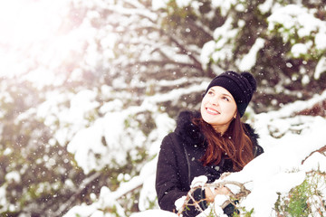 Young smiling woman on winter forest background