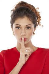 Young women with finger on lips