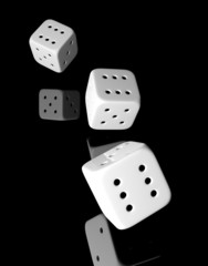 Three rolling white dices of six isolated on white