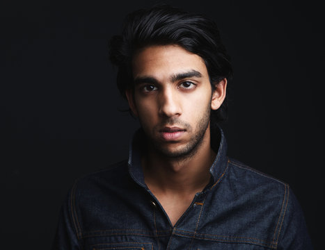 Portrait of a young man with denim jeans jacket