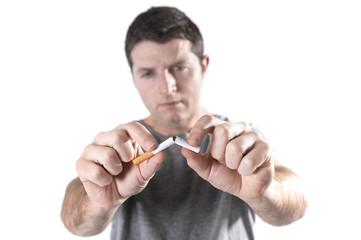 man breaking cigarette representing quit smoking