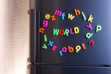 Word World spelled out using colorful magnetic letters