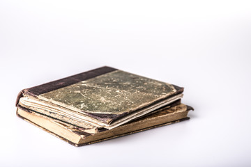 Beautiful old two books closeup on white background