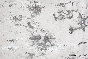 Old white concrete wall with paint cracks. Background texture