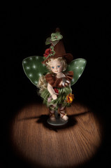 fairy figurine on a black background