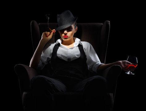 Mafiosi woman with cigar and cognac glass
