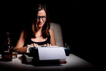 Novelist writing a book on a typewriter