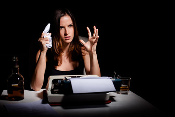 Novelist is angry and frustrated because she's having a writer's