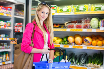 Beautiful young woman shopping for fruits and vegetables