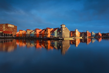 Wall Mural - multicolor buildings on water in sunshine