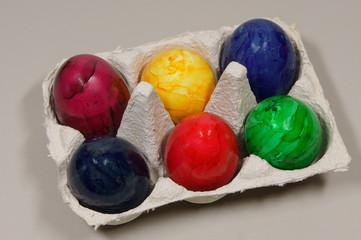 colored eggs in a box