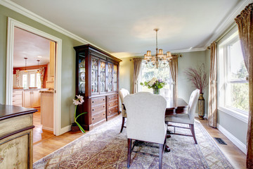 Olive and brown dining room with aristocratic furniture