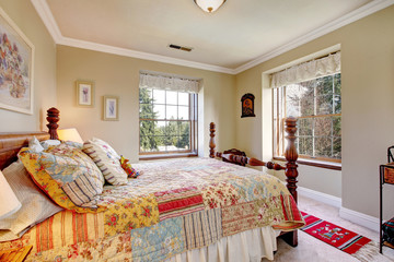 Warm colors bedroom with an old-fashioned bed