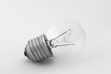 Light bulb in natural light on white background