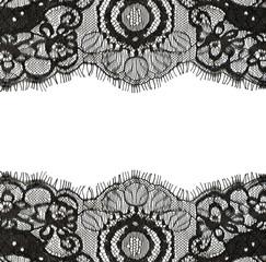 Black lace edges on white background