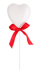 White heart and red ribbon with a bow Isolated on white backgrou