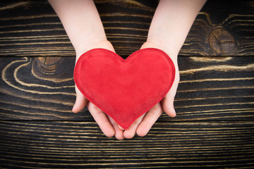 Red  heart in children's hands