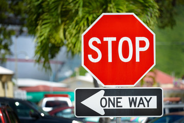 Stop and one way sign on a street