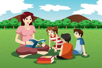 Teacher reading book to kids