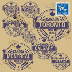 Grunge rubber stamp set with names of Canada cities