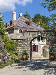 picturesque house with a stone gate