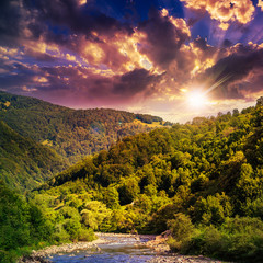 wild mountain river on a hot summer evening