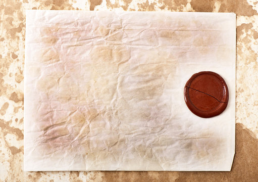 sheet of old paper with a wax seal on old paper background