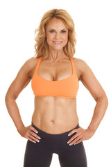 Mature woman orange bra stand hands hips