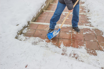 Man shovelling snow from the sidewalk 2