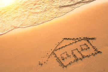 House painted on beach sand.