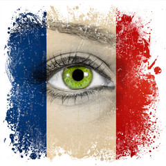 France flag painted on face with green eye