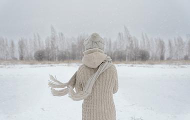 Woman on a meadow in winter