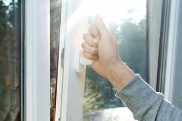 hand open window