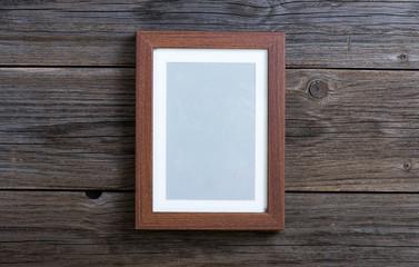 brown frame on wood background