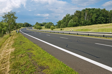 Empty highway passing landscape Wall mural