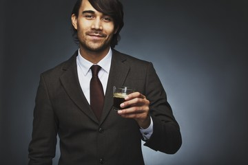 Business man offering you a cup of coffee