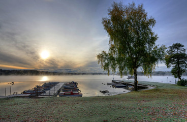 Swedish lake boat harbor in autumn season