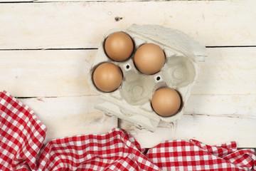 Paquete de media docena de huevos