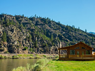 Wide Mountain River and a Log Cabin - Clark Fork River MT USA