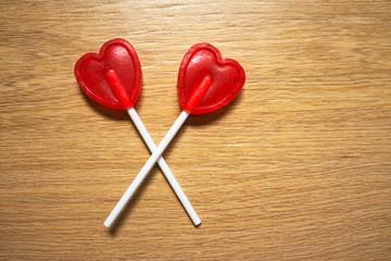 Red heart lollipops in X