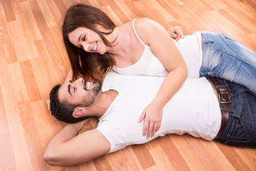 Couple relaxing on the floor